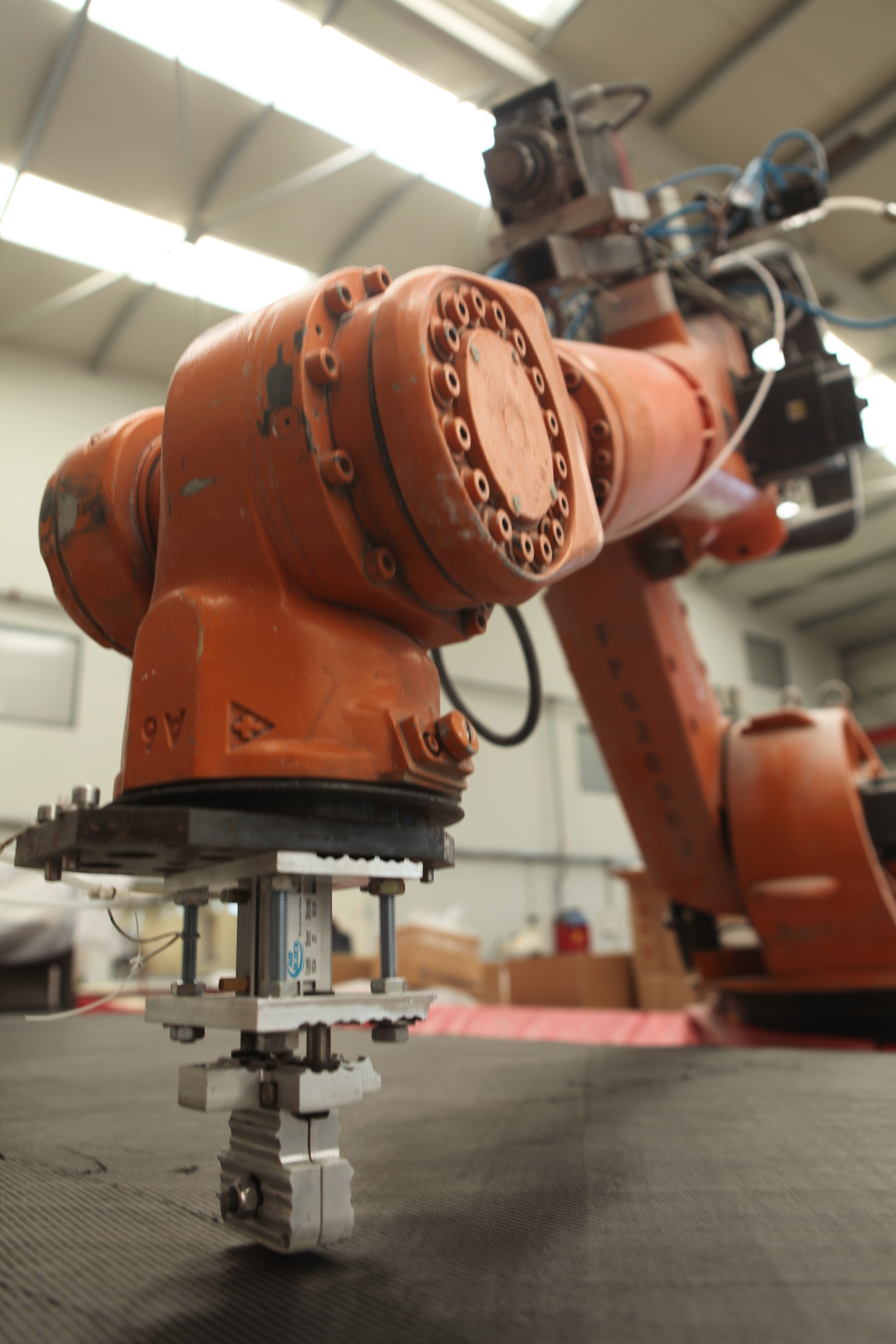 Robot CNC caron-fiber cut with in-house manipulator & cam software
